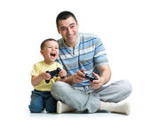 Man and his son child play with a playstation together — Stock Photo