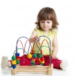 Pretty kid with educational toy — Stock Photo #47627981