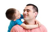 Criança feliz, abraçando seu pai isolado no branco — Fotografia Stock