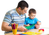 Kid boy and his dad playing together — Stock Photo