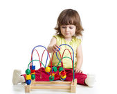 Pretty kid with educational toy — Stock Photo