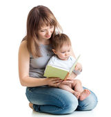 Mother reading a book to her baby boy — Stock Photo