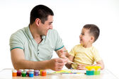 Happy kid and dad paint together — Stock Photo
