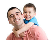 Happy father with his kid son on his back isolated on white — Stock Photo