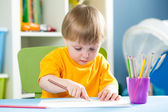 Child drawing with pencils indoors — Stock Photo