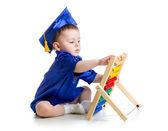 Baby met academische kleren abacus spelen — Stockfoto