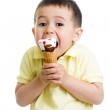 Happy kid boy eating ice cream in studio isolated — Stock Photo #47885785