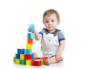 Baby toddler playing with building block toys — Stock Photo