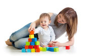 Baby boy and mother playing together with  toys — Stock Photo