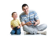 Man and his son play with a playstation together — Stock Photo