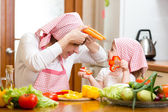 Woman and kid girl cooking and having fun — Stock Photo