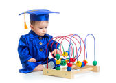 Baby in academician clothes  with educational toy — Stock Photo