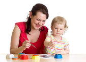 Mother and child girl painting together — Stock Photo