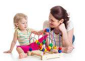 Child boy and mother play with color educational toy — Stock Photo