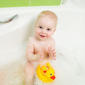 Happy kid boy bathing  and playing with toys — Stock Photo