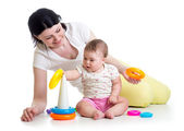Kid girl and mother playing together with toy — Stock Photo