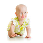 Baby girl crawling on floor over white background — Stock Photo