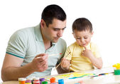 Kid boy and dad paint together — Stock Photo