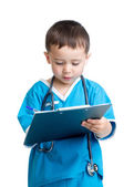 Child boy uniformed as doctor writing to clipboard — Stock Photo