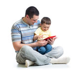 Child and father looking to play and read tablet computer — Stock Photo