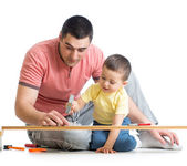 Kid and his dad working together — Stock Photo