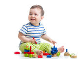 Cheerful kid with construction set over white background — Stock Photo