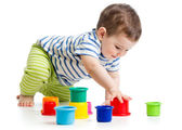 Toddler boy playing with cup toys — Stock Photo