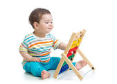 Baby playing with abacus — Stock Photo