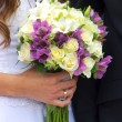 Stock Photo: Wedding bouquet in bride's hand