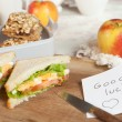 Lucky note in lunchbox — Stock Photo
