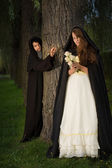 Monk and angel — Stock Photo