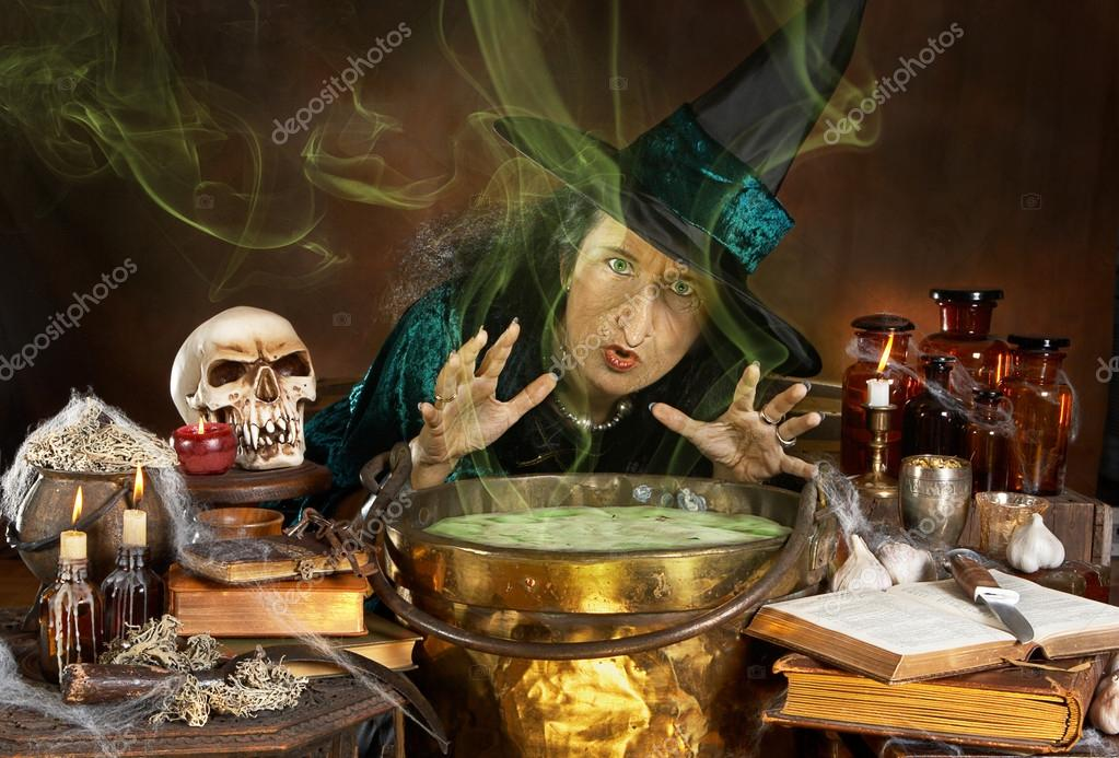 Ugly old halloween witch casting a spell over her cauldron  Stock Photo #12739852