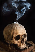 Candle on skull 7 — Stock Photo