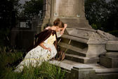Mourning on a tomb — Stock Photo