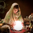 Scrying with a crystal ball — Stock Photo #13046622