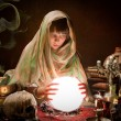 Scrying with a crystal ball - Stock Photo