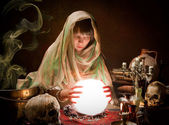 Scrying with a crystal ball — Stock Photo