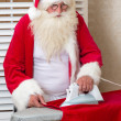 Santa Claus doing chores — Stock Photo #13272902