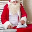 Santa Claus doing chores — Stock Photo