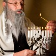 Stock Photo: Lighting the menorah
