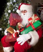 Santa with presents — Stock Photo