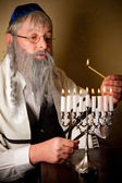Lighting the menorah — Stock Photo