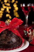 Plum pudding and christmas tree — Stock Photo