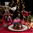 Постер, плакат: Lighting the plum pudding