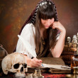 Witch writing in the book of shadows — Foto de Stock