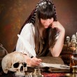 Witch writing in the book of shadows — Foto Stock