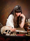 Witch writing in the book of shadows — Stock Photo