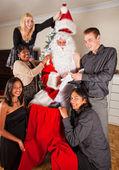 Dressing up Santa for christmas — Stock Photo