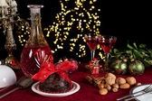 Christmas table with plum pudding — Stock Photo