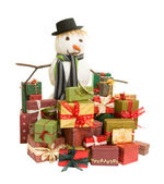 Snowman and christmas presents — Stock Photo